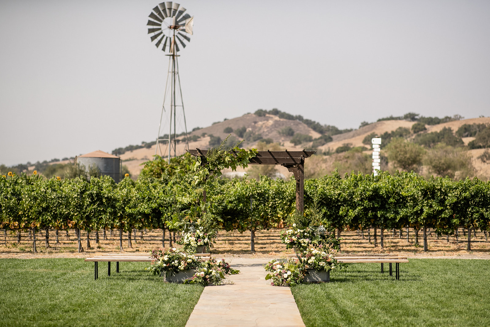 Pergola with windmill behind